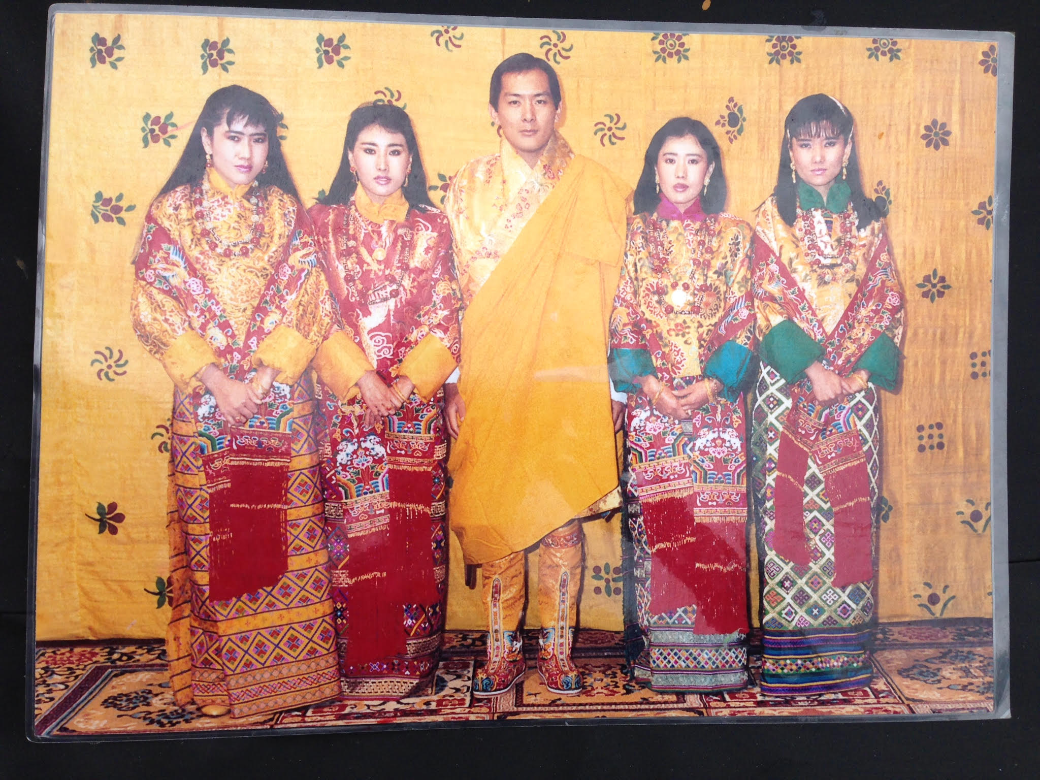 The retired king of Bhutan with his four wives, all sisters